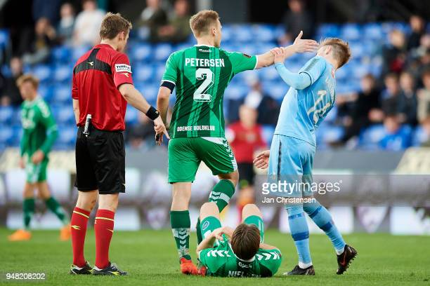 Kenneth Emil Petersen of OB Odense and Frederik Lauenborg of Randers FC in discussion during the Danish Alka Superliga match between Randers FC and...