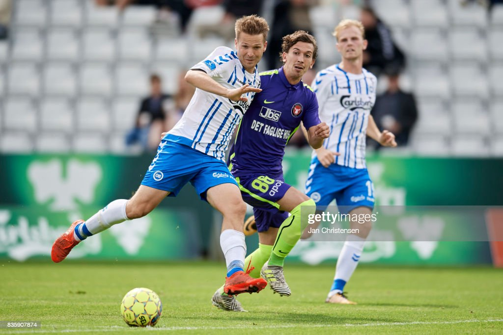 Kenneth Emil Petersen of OB Odense and Gustav Wikheim of FC Midtjylland compete for the ball during the Danish Alka Superliga match between OB Odense and FC Midtjylland at TREFOR Park on August 20, 2017 in Odense, Denmark.
