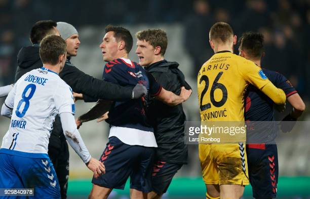 Kenneth Emil Petersen of OB Odense shows frustration against Dino Mikanovic of AGF Aarhus and Daniel A Pedersen Jens Stage and Goalkeeper Aleksandar...