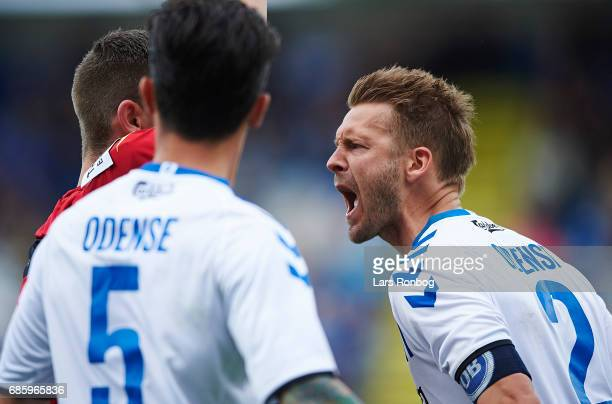 Kenneth Emil Petersen of OB Odense shows frustration against Referee Anders Poulsen during the Danish Alka Superliga match between OB Odense and...