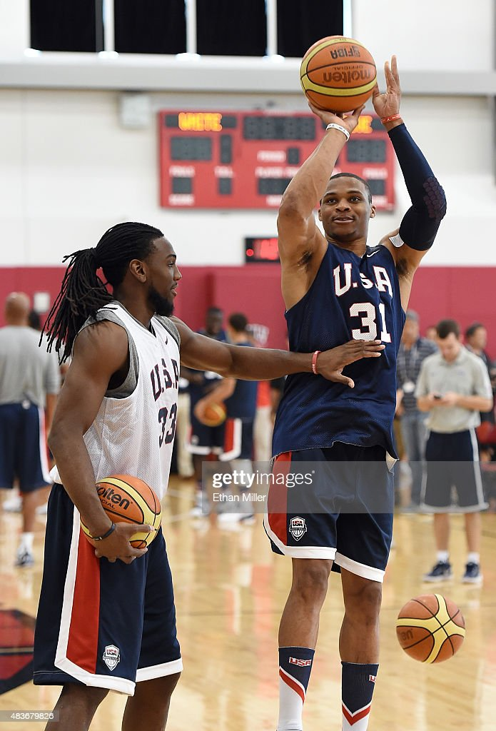 Kenneth Faried #33 and Russell Westbrook #31 of the 2015 USA Basketball Men's National Team joke around during a practice session at the Mendenhall Center on August 11, 2015 in Las Vegas, Nevada.