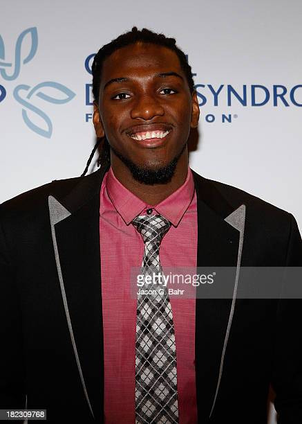 Kenneth Faried of the Denver Nuggets attends the Global Down Syndrome Foundation's Be Yourself Be Beautiful Fashion Show at Sheraton Downtown Denver...