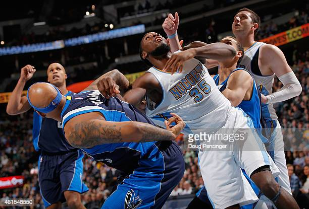 Kenneth Faried of the Denver Nuggets battles for rebounding position with Charlie Villanueva of the Dallas Mavericks at Pepsi Center on January 14...
