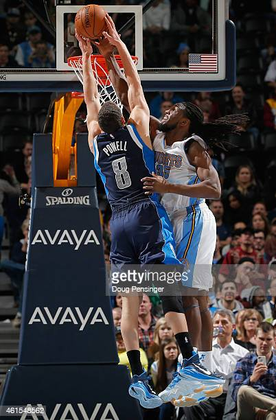 Kenneth Faried of the Denver Nuggets blocks a shot by Dwight Powell of the Dallas Mavericks at Pepsi Center on January 14 2015 in Denver Colorado...