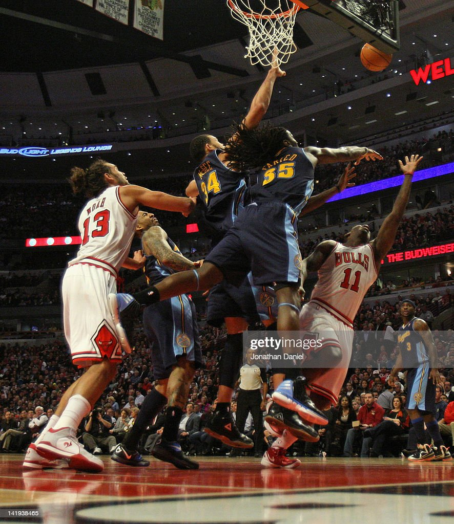 Kenneth Faried #35 of the Denver Nuggets blocks a shot by Ronnie Brewer #11 of the Chicago Bulls as JaVale McGee #34 defends in front of Joakim Noah #13 at the United Center on March 26, 2012 in Chicago, Illinois. The Nuggets defeated the Bulls 108-91.