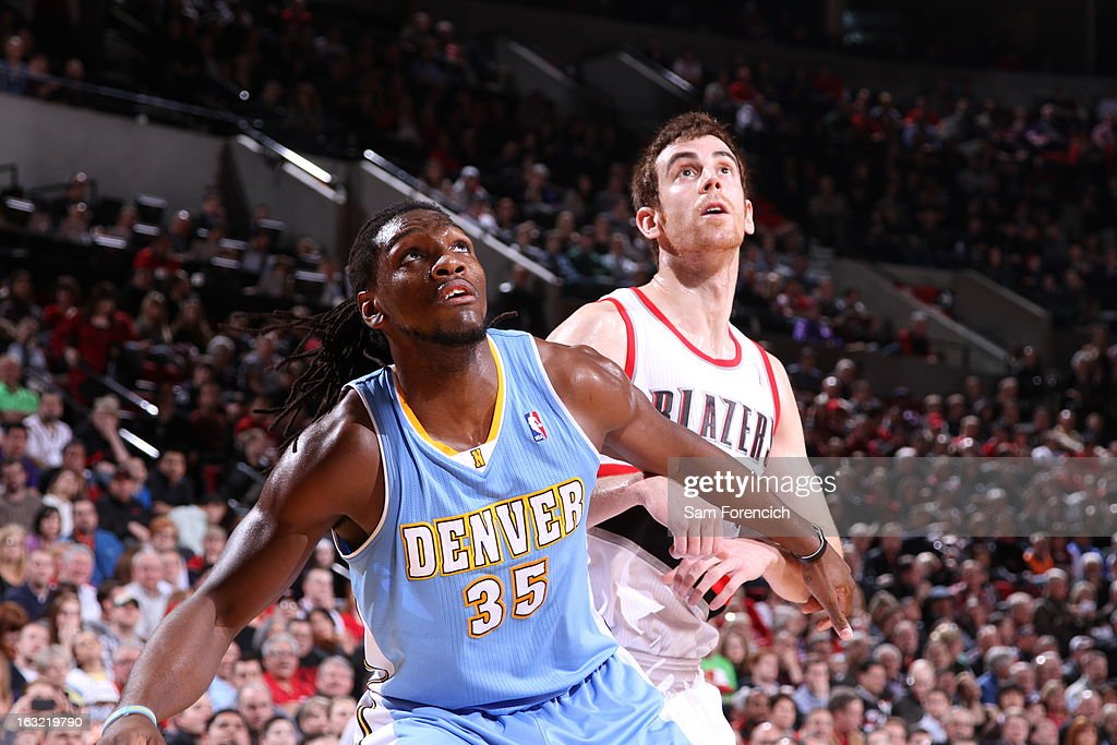Kenneth Faried #35 of the Denver Nuggets boxes out Victor Claver #18 of the Portland Trail Blazers on February 27, 2013 at the Rose Garden Arena in Portland, Oregon.