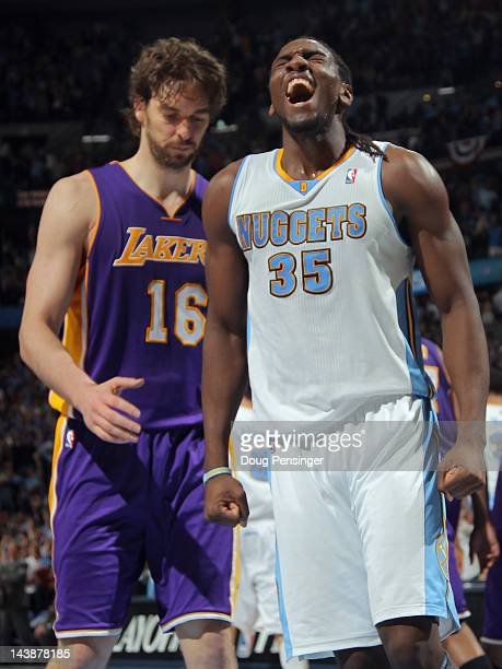 Kenneth Faried of the Denver Nuggets celebrates as Pau Gasol of the Los Angeles Lakers looks on as the Nuggets defeated the Lakers 9984 in Game Three...