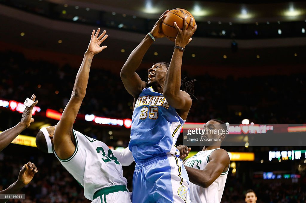 Kenneth Faried #35 of the Denver Nuggets drives to the basket in front of Paul Pierce #34 and Jeff Green #8 of the Boston Celtics during the game on February 10, 2013 at TD Garden in Boston, Massachusetts.