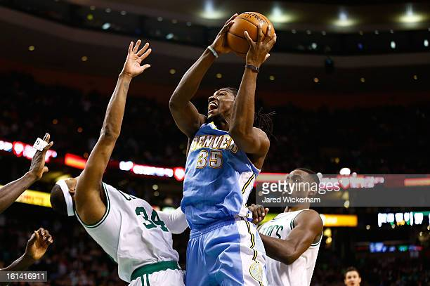 Kenneth Faried of the Denver Nuggets drives to the basket in front of Paul Pierce and Jeff Green of the Boston Celtics during the game on February 10...