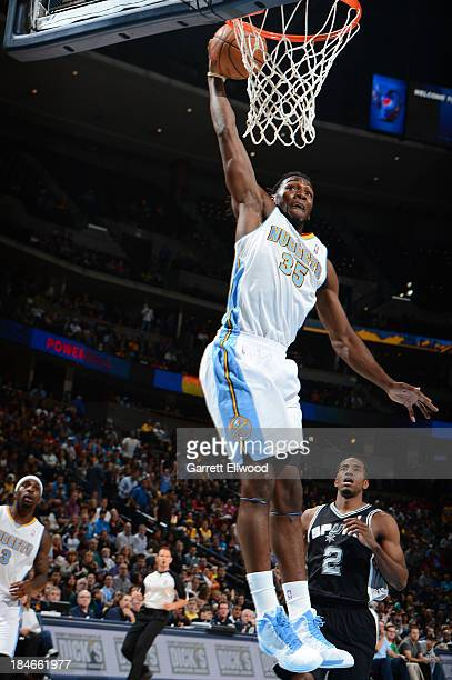 Kenneth Faried of the Denver Nuggets dunks against the San Antonio Spurs on October 14 2013 at the Pepsi Center in Denver Colorado NOTE TO USER User...