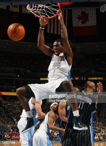 Kenneth Faried of the Denver Nuggets dunks the ball against Glen Davis of the Orlando Magic at Pepsi Center on April 22 2012 in Denver Colorado NOTE...