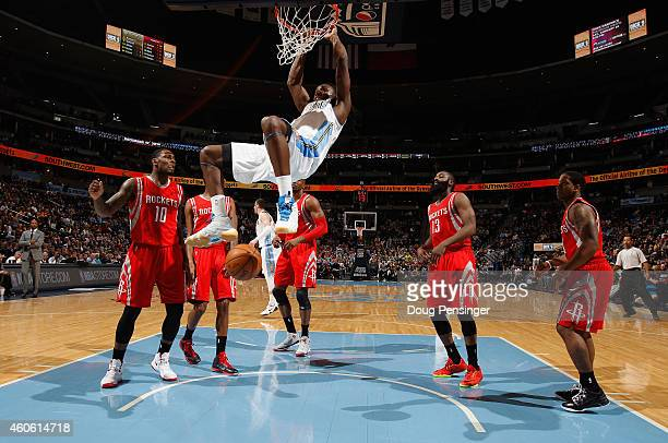 Kenneth Faried of the Denver Nuggets dunks the ball against the Houston Rockets at Pepsi Center on December 17 2014 in Denver Colorado NOTE TO USER...