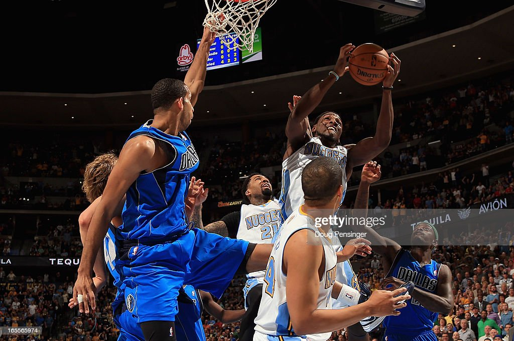 Kenneth Faried #35 of the Denver Nuggets grabs a rebound in a crowd against the Dallas Mavericks at the Pepsi Center on April 4, 2013 in Denver, Colorado. The Nuggets defeated the Mavericks 95-94.