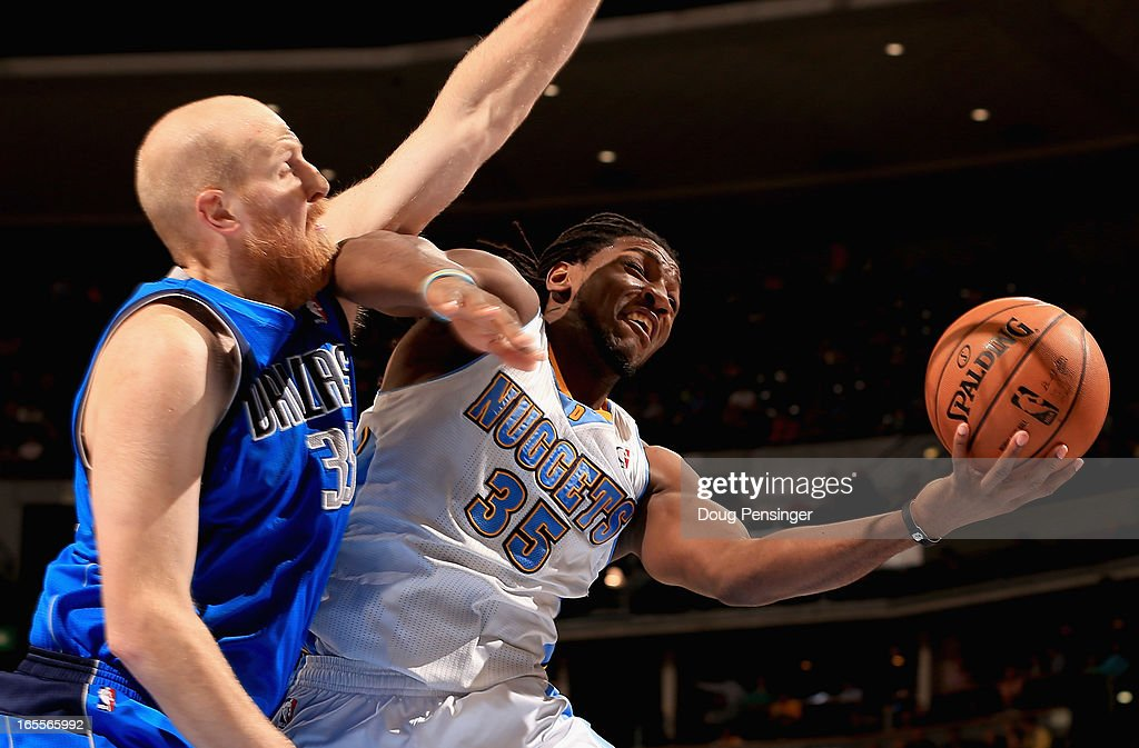 Kenneth Faried #35 of the Denver Nuggets is fouled by Chris Kaman #35 of the Dallas Mavericks at the Pepsi Center on April 4, 2013 in Denver, Colorado. The Nuggets defeated the Mavericks 95-94.