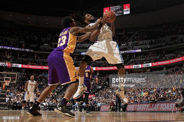 Kenneth Faried of the Denver Nuggets is fouled by Louis Williams of the Los Angeles Lakers as he tries to take a shot at Pepsi Center on December 22...