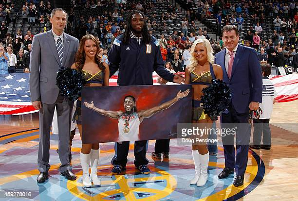 Kenneth Faried of the Denver Nuggets is recognized by the assistant general manager Arturas Karnisovas of the Denver Nuggets and Jim Tooley CEO of...