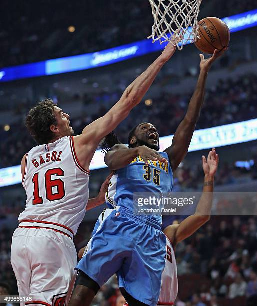 Kenneth Faried of the Denver Nuggets puts up a shot against Pau Gasol of the Chicago Bulls at the United Center on December 2 2015 in Chicago...