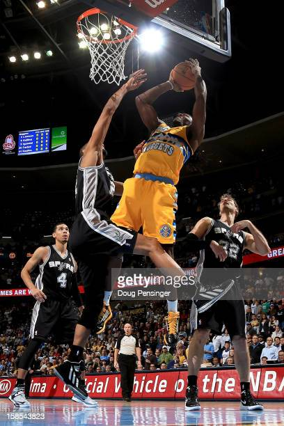 Kenneth Faried of the Denver Nuggets takes a shot against Tim Duncan of the San Antonio Spurs at the Pepsi Center on December 18 2012 in Denver...