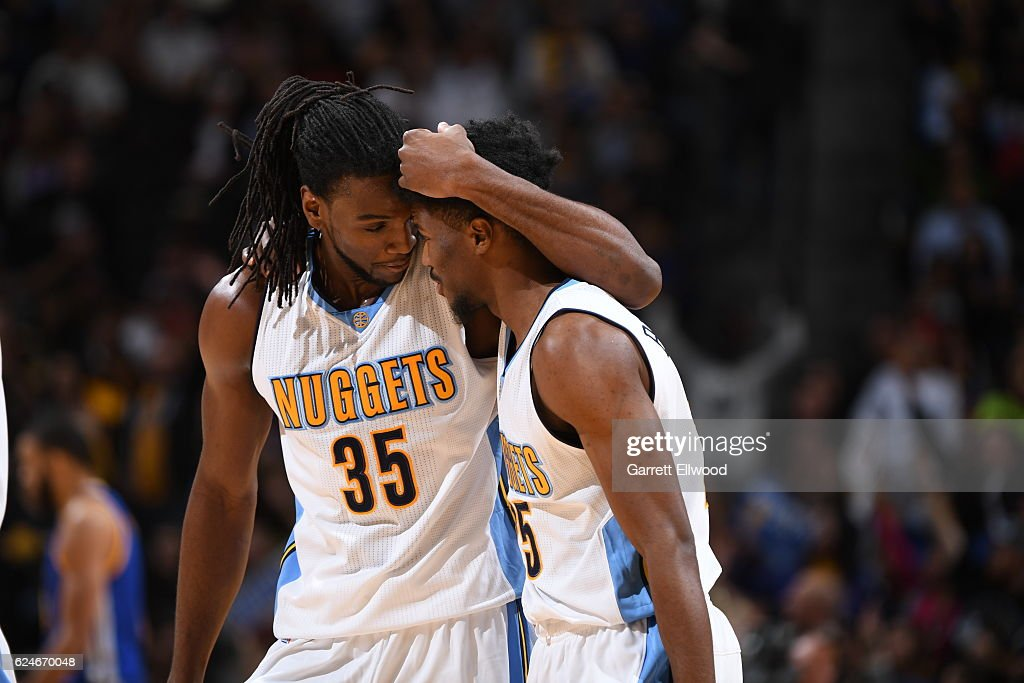 Kenneth Faried #35 of the Denver Nuggets talks with Will Barton #5 of the Denver Nuggets during the game against the Golden State Warriors on November 10, 2016 at the Pepsi Center in Denver, Colorado.