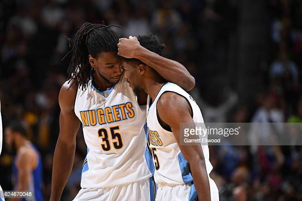Kenneth Faried of the Denver Nuggets talks with Will Barton of the Denver Nuggets during the game against the Golden State Warriors on November 10...