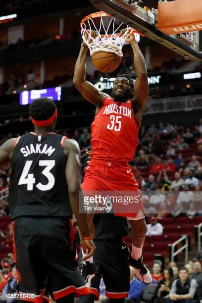 Kenneth Faried of the Houston Rockets dunks the ball defended by Serge Ibaka of the Toronto Raptors and Pascal Siakam in the first half at Toyota...