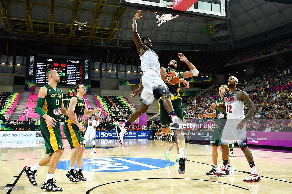 Kenneth Faried #7 of the USA Basketball Men's National Team dunks the ball against Lithuania Basketball Men's National Team during a 2014 FIBA Basketball World Cup semi-final match between USA and Lithuania at Palau Sant Jordi on September 11, 2014 in Barcelona, Spain.
