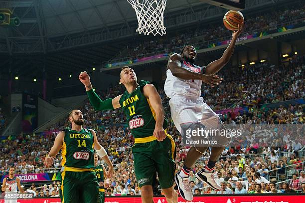 Kenneth Faried of the USA Basketball Men's National Team shoots against Donatas Motiejunas of the Lithuania Basketball Men's National Team during a...