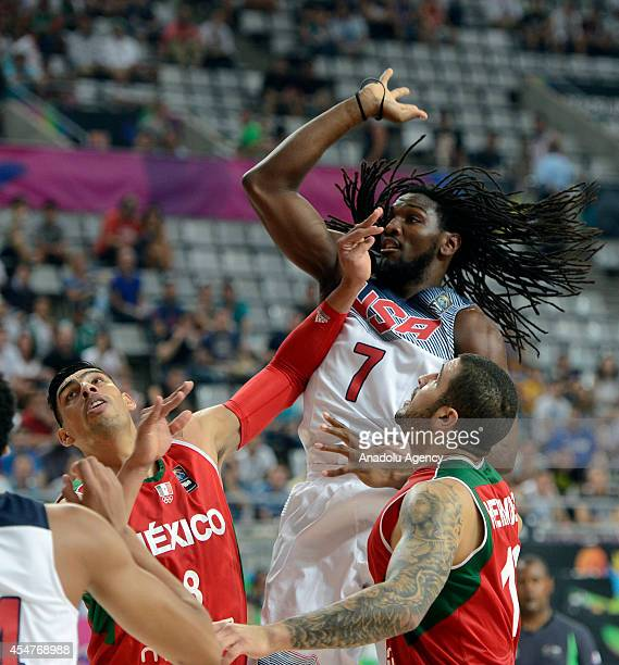 Kenneth Faried of USA in action against Gustavo Ayon and Hector Hernandez of Mexico during the 2014 FIBA Basketball World Cup Round of 16 match...