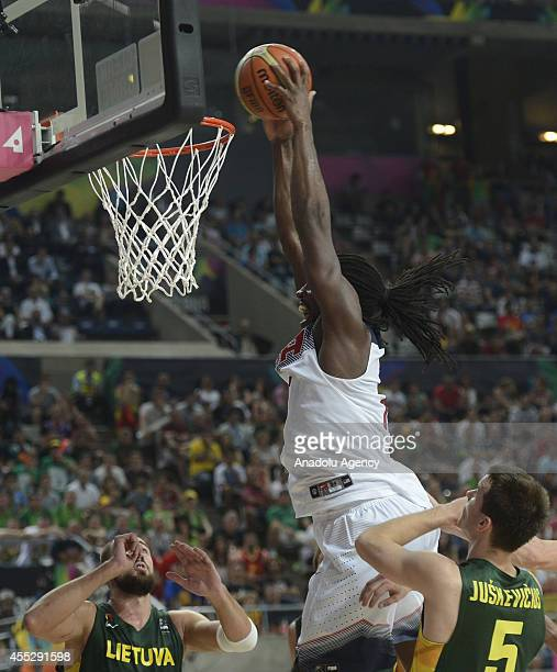 Kenneth Faried of USA is in action against Adas Juskevicius of Lithuania during 2014 FIBA World Basketball Championship SemiFinal basketball match...