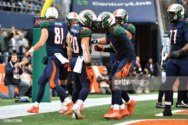 Kenneth Farrow and Alonzo Moore of the Seattle Dragons celebrate after a touchdown during the XFL game against the Dallas Renegades at CenturyLink...