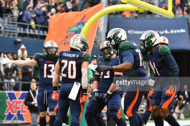 Kenneth Farrow and Kirk Barron of the Seattle Dragons celebrate after a touchdown during the XFL game against the Dallas Renegades at CenturyLink...