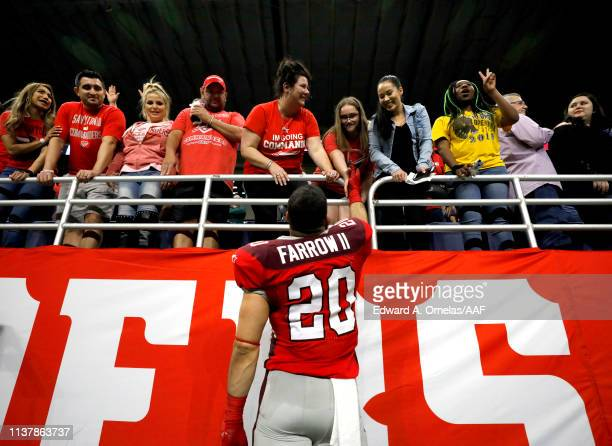 Kenneth Farrow, II of the San Antonio Commanders celebrates his team's 19-15 win over the Salt Lake Stallions with fans after the Alliance of...