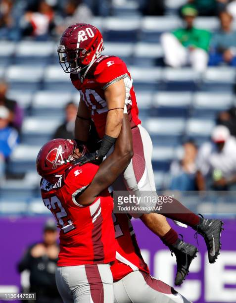 Kenneth Farrow II of the San Antonio Commanders is congratulated by his teammate Jaryd JonesSmith after scoring a rushing touchdown against the...