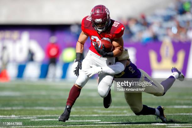 Kenneth Farrow, II of the San Antonio Commanders is wrapped up by Khalil Bass of the Atlanta Legends during the first half in the Alliance of...
