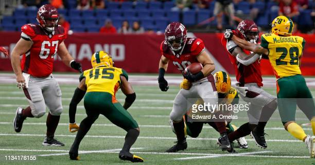 Kenneth Farrow II of the San Antonio Commanders tries to shake the tackle of Will Sutton III of the Arizona Hotshots during an Alliance of American...