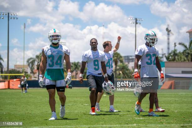 Kenneth Farrow, Mark Walton, Patrick Laird, Kenneth Farrow, and Kenyon Drake of the Miami Dolphins head to the locker room after practice during the...