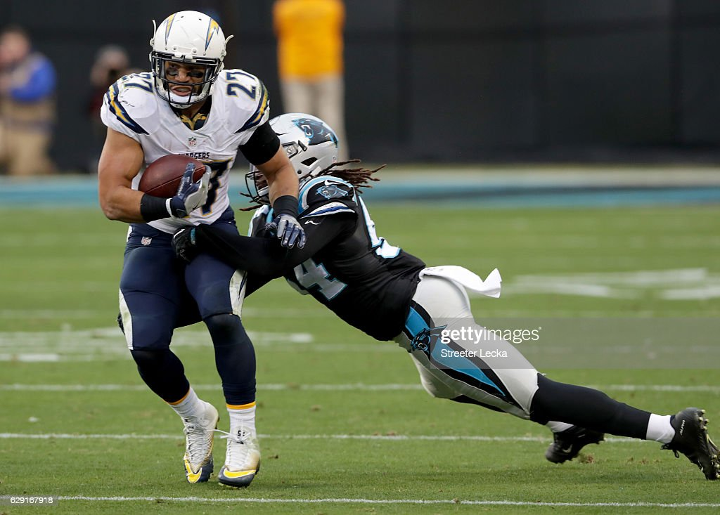 Kenneth Farrow #27 of the San Diego Chargers runs the ball against Shaq Green-Thompson #54 of the Carolina Panthers in the 4th quarter during their game at Bank of America Stadium on December 11, 2016 in Charlotte, North Carolina.