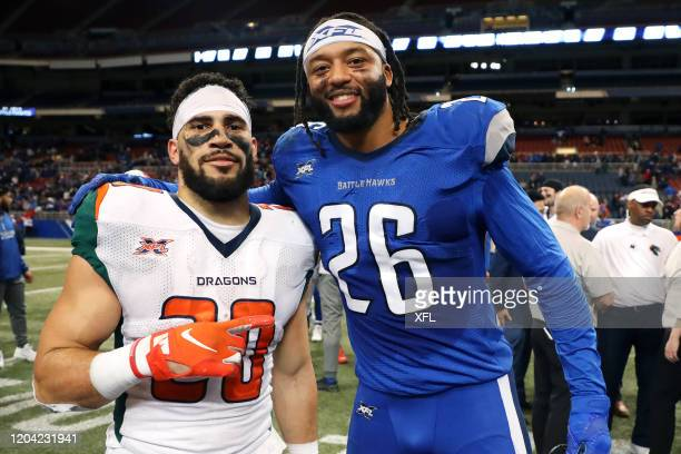 Kenneth Farrow of the Seattle Dragons and Dexter McCoil of the St. Louis BattleHawks pose for a photo after the XFL game at The Dome at America's...