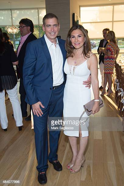 Kenneth Fishel and Maria Fishel attend the Hamptons Magazine and Bespoke Real Estate VIP Dinner on August 14 2015 in Water Mill New York