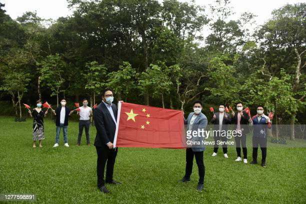 Kenneth Fok Kai-kong , vice chairman of All-China Youth Federation, and Clarence Leung , vice chairman of All-China Youth Federation, pose with a...