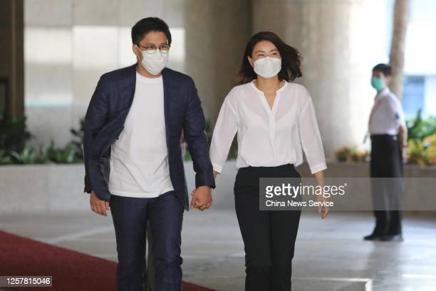 Kenneth Fok Kai-kong, vice-president of the Fok Ying Tung Group, and his wife Guo Jingjing walk to the media after submitting an application for the...