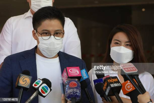 Kenneth Fok Kai-kong, vice-president of the Fok Ying Tung Group, speaks to the media next to his wife Guo Jingjing after submitting an application...