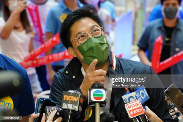 Kenneth Fok Kai-kong, vice-president of the Sports Federation and Olympic Committee of Hong Kong, watches the live broadcast of Hong Kong's Lee Wai...