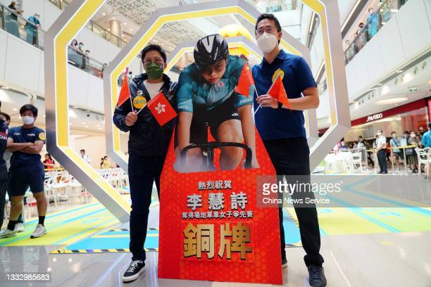 Kenneth Fok Kai-kong , vice-president of the Sports Federation and Olympic Committee of Hong Kong, poses with the cardboard cutout of Hong Kong's...