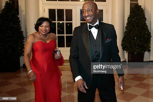 Kenneth Frazier president and chief executive officer of Merck and Co right and his wife Andrea Frazier arrive at a state dinner hosted by US...
