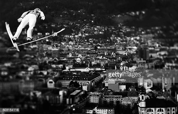 Kenneth Gagnes of Norway soars over Innsbruck during his qualification jump on Day 1 of the Innsbruck Four Hills Tournament on January 2 2016 in...