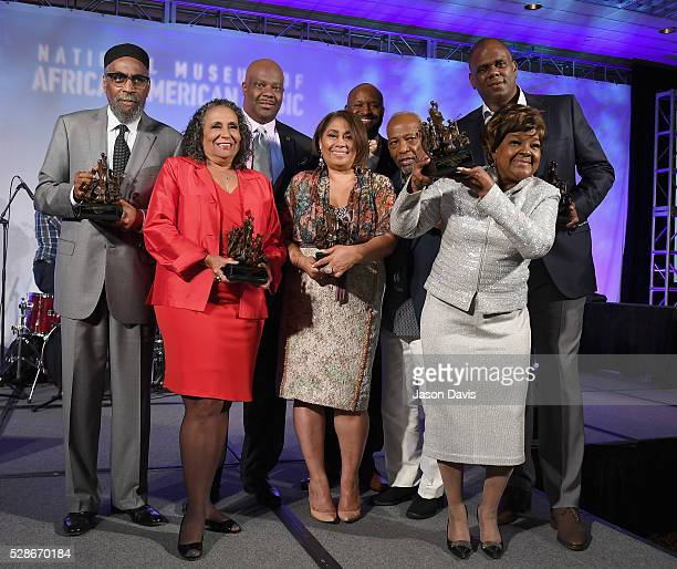 Kenneth Gamble Cathy Hughes Shannon Sanders Dyana Williams H Beecher Hicks III Leon Huff Shirley Caesar and Jon Platt pose onstage during NMAAM's...