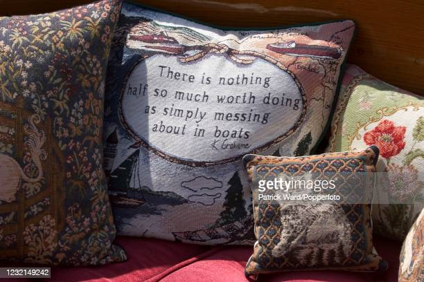 Kenneth Grahame quote embroidered on a pillow on a slipper launch at the Thames Traditional Boat Rally on the River Thames, circa July 2005. An image...
