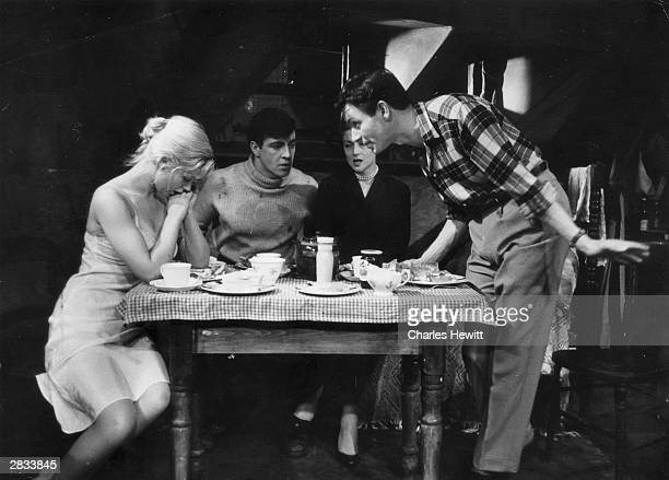 Kenneth Haigh right Helena Hughes Alan Bates and Mary Ure left at the Royal Court Theatre in London in John Osborne's production of 'Look Back in...