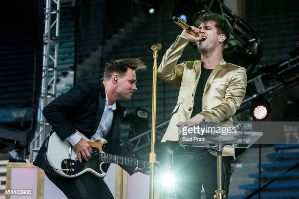 Kenneth Harris and Brendon Urie of Panic at the Disco performs at the Bumbershoot Music and Arts Festival on August 30 2014 in Seattle Washington